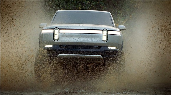 Ford is investing $500 million in electric pickup truck maker Rivian, saying the two companies will work together to develop ...