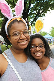 Thousands of people, including the Easter Bunny, stroll along Monument Avenue for what may be the final edition of Easter on Parade. Ogechi Mbagwu, 21, and her sister, Nasreen Mbagwu, 11, of Damascus, Md., show off the rabbit ears they donned for the Monument Avenue event.