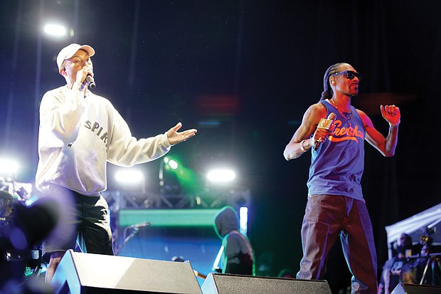 """""""Something in the Water"""" is the brainchild of Virginia Beach native Pharrell Williams, left, who performed Saturday under the banner """"Pharrell & Friends."""" Here, he is joined on stage by Snoop Dogg."""