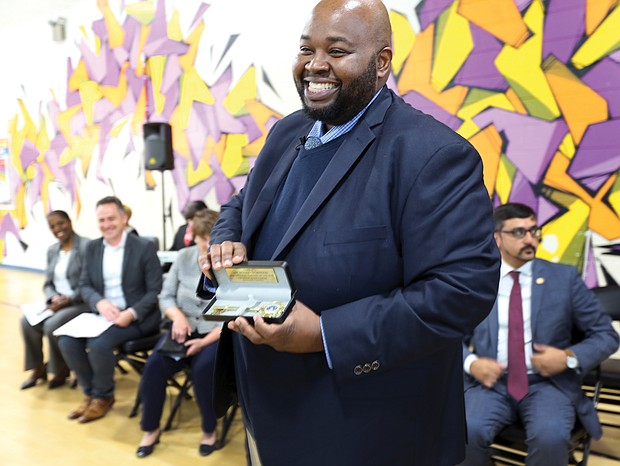 Award-winning teacher Rodney A. Robinson shows off the key to the City of Richmond presented to him by Mayor Levar M. Stoney during a ceremony last Thursday at the Virgie Binford Education Center inside the Richmond Juvenile Detention Center, where he teaches.