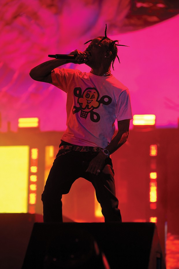 Performer Travis Scott plays to the  audience.