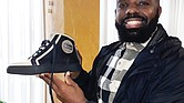 Michael D. Duke hopes to carve out his niche in high-fashion footwear starting with a sneaker line he designed and is selling on line. An Italian company produces the leather and suede shoe.