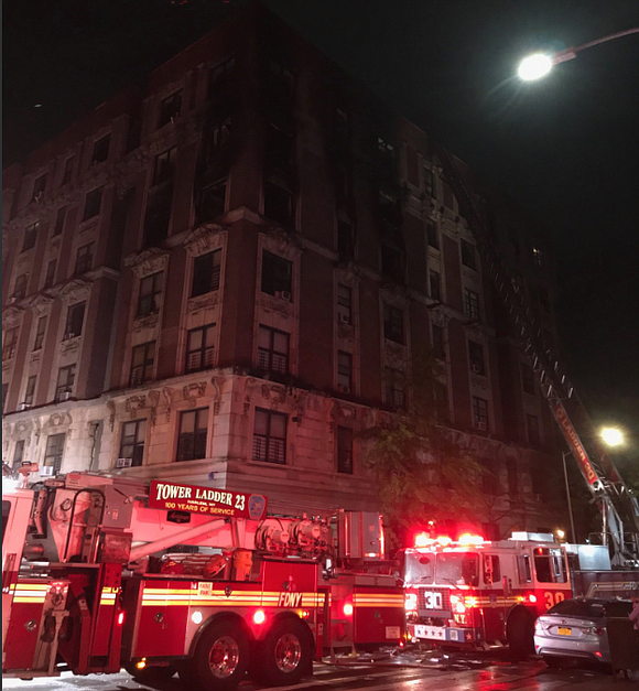 Six people, including four children, are dead after a fire tore through a NYCHA apartment in Harlem early Wednesday.