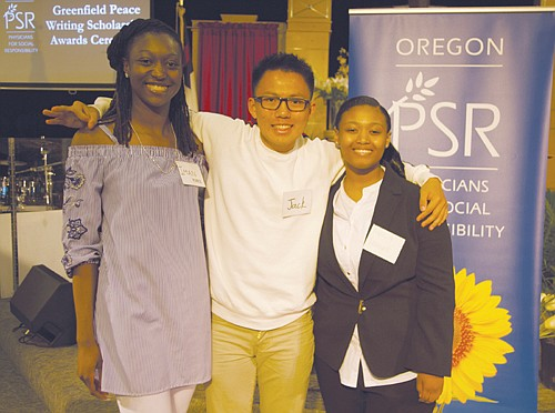 Iman Pearce (from left), Jack Hill and Alyssia Maxwell are honored for their participation in a high school writing competition to raise the public's consciousness on  systemic racism and help make the world more healthy and peaceful. The contest was sponsored by Oregon Physicians for Social Responsibility.