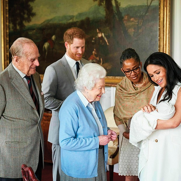 A royal arrival for Mother's Day: New mother Meghan Markle, the Duchess of Sussex, holds her son, Archie Harrison Mountbatten-Windsor, as he is admired Wednesday by his grandmother, Doria Ragland, and great-grandmother, Queen Elizabeth II. Smiling from the side are the baby's great-grandfather, Prince Philip, and new father, Prince Harry. The baby, born Monday to Prince Harry and Ms. Markle, is the first grandchild for Ms. Ragland and the eighth great-grandchild for the 93-year-old British monarch and the Duke of Edinburgh. (Chris Allerton©SussexRoyal)