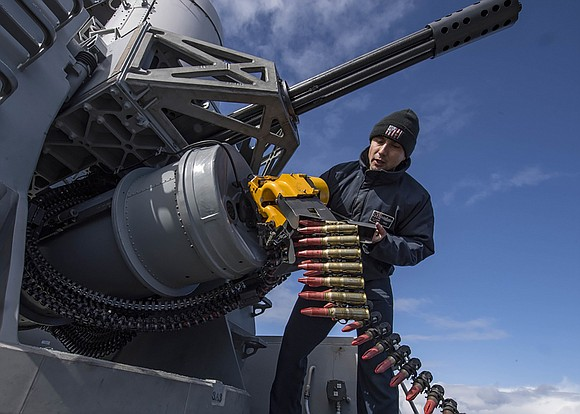 Fire Controlman 1st Class Alexander Perez, from Houston, reloads a phalanx close-in weapons system aboard the Arleigh Burke-class guided-missile destroyer ...