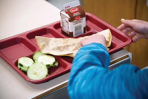 It's the first time a state has offered to completely take on school meal costs, which can often run tens ...