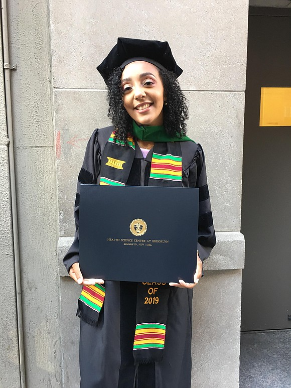 Proud College of Medicine graduate Alexandra Fayne, M.D., was one of over 400 students to receive her degree and diploma ...