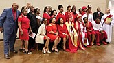 Bishop Phoebe Roaf, holding the crosier, pauses for a photo with a contingent from St. Philip's Episcopal Church in Richmond following her consecration May 4 as bishop of West Tennessee. Seated next to Bishop Roaf is retired Bishop Shannon Johnston of the Diocese of Virginia.  (photo courtesy of St. Phillip's Episcopal Church)