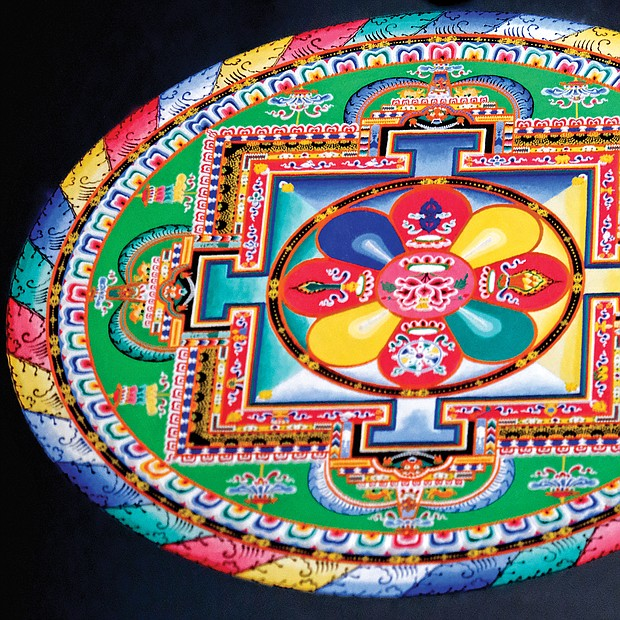 "Mandala: Sacred art/Tibetan Buddhist monks from the Drepung Loseling Monastery in India create a sand mandala at the Virginia Museum of Fine Arts recently to share Tibet's sacred visual and performing arts with area audiences. The monks' work, created over four days, was completed in conjunction with the VMFA's new exhibit, ""Awaken: A Tibetan Buddhist Journey Toward Enlightenment,"" that features roughly 100 historical and contemporary objects highlighting the role of art in Tibetan Buddhist culture and religious practices. (Sandra Sellars/Richmond Free Press)"