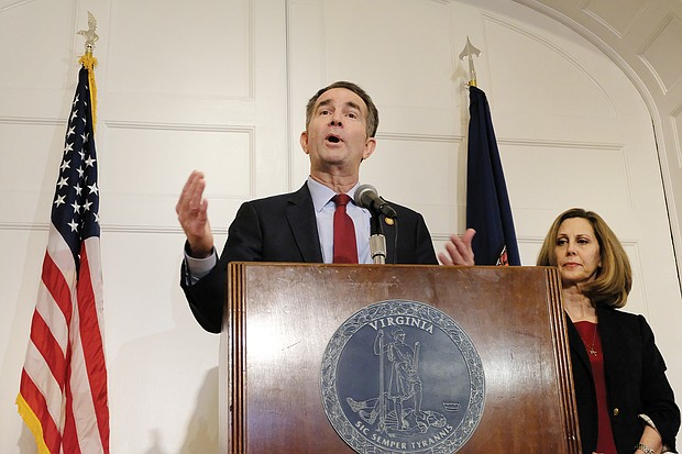 After apologizing a day earlier, the governor backpedals during a Feb. 2 news conference at the Executive Mansion, saying that he is neither person in the racist photo on his yearbook page. However, he admitted during the news conference that he wore blackface to portray superstar Michael Jackson during a 1984 dance contest. First Lady Pam Northam listened in the background.
