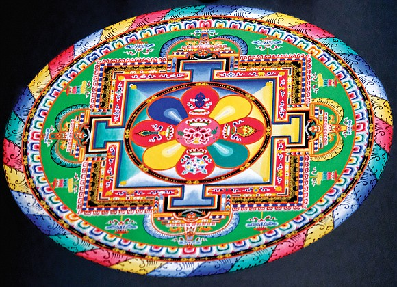 Tibetan Buddhist monks from the Drepung Loseling Monastery in India create a sand mandala at the Virginia Museum of Fine ...