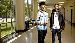 Round Rock High School senior Ahmir Johnson (left) and junior Addison Favors are among students of color who fear an expansion of the state's school marshal program will impact them more than others.
