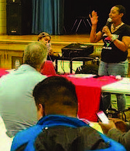 The Resident Association of Greater Englewood (RAGE) recently hosted a village meeting for residents at the Dr. Martin Luther King Jr. Academy of Social Justice. Photo Credit: Resident Association of Greater Englewood (RAGE)