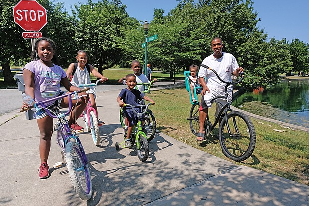 Celebrations of remembrance and fun on Memorial Weekend/ Memorial Day and the holiday weekend was a time for remembrance and fun for people throughout the Richmond area. Families and friends enjoyed outdoor activities during the weekend. Andre Quarles, right, rides his 2-year-old daughter, Aniya, through Byrd Park on Saturday, accompanied by other family members, from left, Ki'najma Quarles, 8; Alaura Oliver, 9; Ce'ondre Bland, 5; and Elijah Bland, 7. (Sandra Sellars/Richmond Free Press)