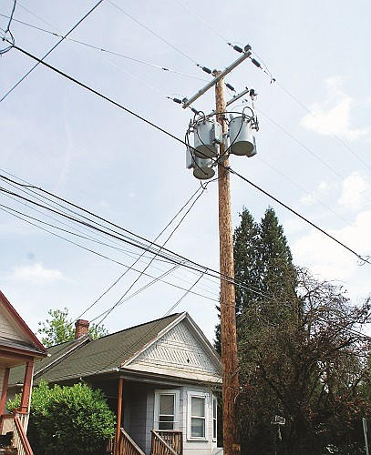 A three-barrel transformer-mounted pole was installed just steps in front of Mary Batson's northeast Portland home without her notification, which caused a water main break. Pacific Power accepted responsibility but may also have to move it because it was installed improperly.