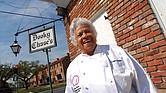 In this March 2007 photo, Leah Chase stands outside of her famous New Orleans restaurant, Dooky Chase's, that was started by her husband's family in the early 1940s.