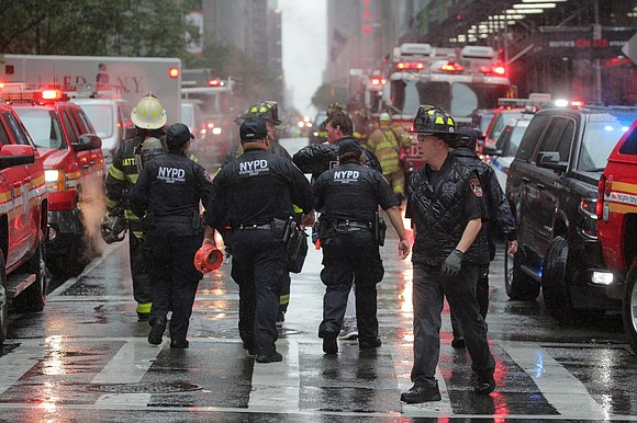 A typical afternoon inside the offices of a Midtown Manhattan skyscraper suddenly turned to chaos Monday when a helicopter, 11 ...