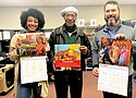 Portland artist Isaaka Shamsud-Din (center) poses with his freshly printed, 2019-2020 artwork calendars in honor of Juneteenth. He is joined by Fyndi Jermany (left) of Don't Shoot Portland and a representative of Morel Ink.