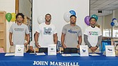 Four John Marshall basketball players reveal their college choices at a ceremony June 5 at the North Side high school. They are, from left, Aubrey Merritt, DeMarr McRae, Levar Allen and Tre Harris-McKenzie.
