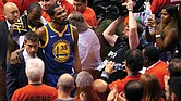 Golden State Warriors forward Kevin Durant, No. 35, glances up at the stands as he is helped off the court Monday night after sustaining an injury to his Achilles tendon during Game 5 of the NBA Finals.