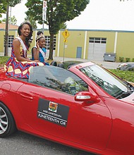 Miss Juneteenth Oregon 2019 Aceia Spade and Little Miss Juneteenth 2019 RinaTchivandja, age 12, ride atop an open convertible.