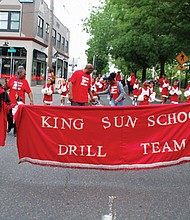 The King Sun School Drill Team marches in the Juneteenth Clara Peoples Freedom Trail Parade.