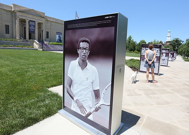 Photos of Richmond tennis star Arthur Ashe Jr. during his 1968 victory at the U.S. Open line the front sidewalk of the Virginia Museum of History & Culture at 428 N. Arthur Ashe Blvd. The installation, featuring rarely seen images of Mr. Ashe by LIFE magazine photographer John Zimmerman, is part of the celebration and dedication of Arthur Ashe Boulevard and will be on view until July 7. The installation was produced for the 2018 U.S. Open commemoration of the 50th anniversary of Mr. Ashe's historic win.