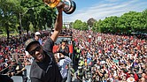 Kawhi Leonard leads the celebration as the Toronto Raptors parade through a sea of adoring fans Monday after upsetting the Golden State Warriors to secure their first NBA title.