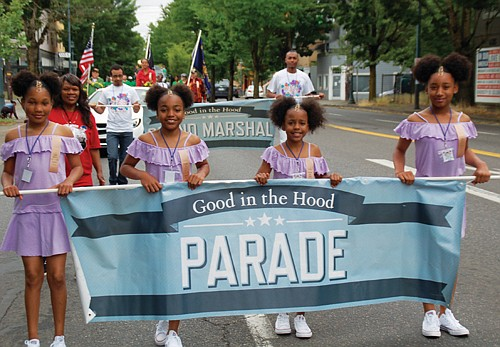 Carrying the banner for the Good in the Hood parade.
