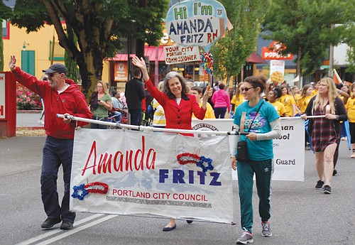 Portland Commissioner Amanda Fritz shares in the community spirit.