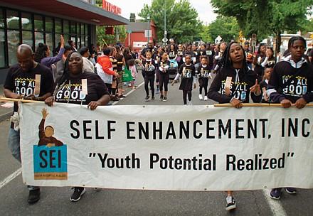 Students from Self Enhancement, Inc. march in Saturday's parade.