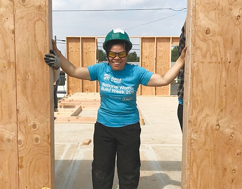 Minh, a single mother and current Cully resident, gets ready to move into her new affordable Habitat for Humanity home in the same Cully neighborhood of northeast Portland.