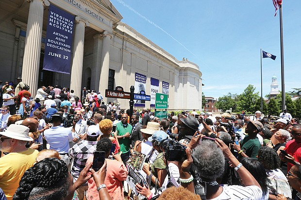 Hundreds of people took photos, including selfies, with the new street signs. (Regina H. Boone/Richmond Free Press)