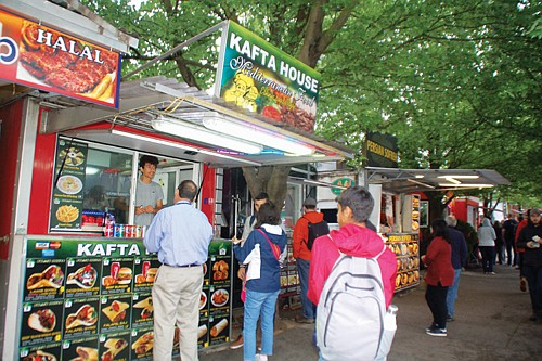 Some of the food carts of the iconic Alder Street Food Cart Pod, downtown, have found a temporary home in ...