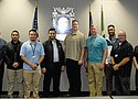 A new group of public safety support specialists and police officers are introduced to the city, flanked by Portland Police Bureau Assistant Chiefs Davis and Sherer.