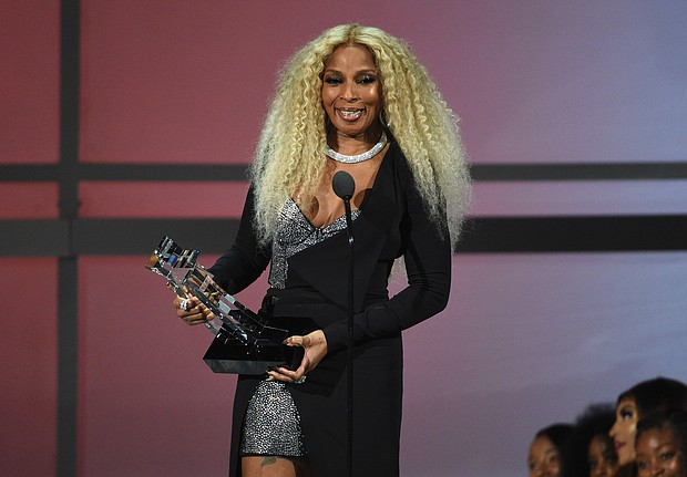 Mary J. Blige accepts the Lifetime Achievement Award at the BET Awards.