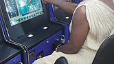 Dr. Joann Henry plays at a bank of slot machines at the Quick N Easy convenience store in the 4100 block of West Broad Street.