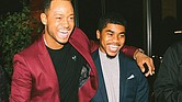 "Jaelon Hodges, right, receives congratulations from actor Terrence Jenkins after learning he was chosen for a $15,000 scholarship for a summer internship with the former BET host of ""106 & Park"" in Los Angeles."