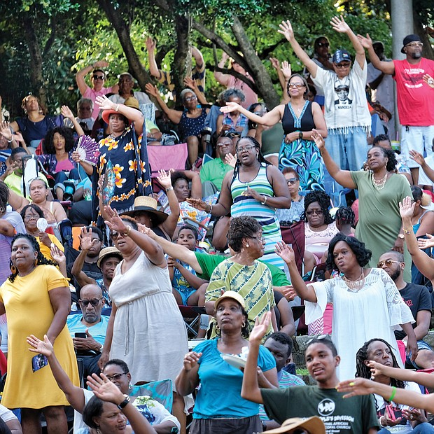 People enjoying the 10th Annual Gospel Music Festival on Sunday at Dogwood Dell. The free event was hosted by Sheilah Belle and Praise 104.7 FM as part of the City of Richmond's Festival of Arts. (Sandra Sellars/Richmond Free Press)