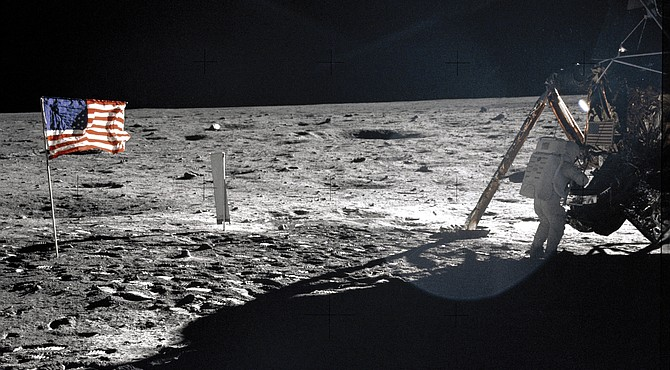 """Astronaut Neil Armstrong, commander of the historic Apollo 11 mission, stands outside the lunar module called """"Eagle"""" during the July 20, 1969, moon landing. Astronaut Buzz Aldrin took the photograph with a Hasselblad 70mm camera. Because Mr. Armstrong took most of the photos as the astronauts worked on the lunar surface, this is one of the few showing Mr. Armstrong on the moon."""