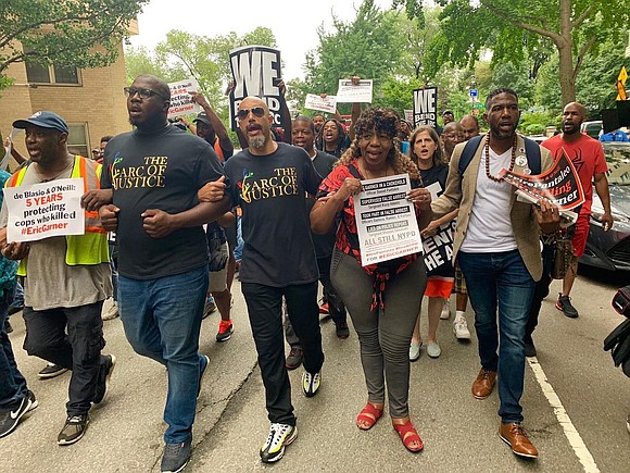 Thousands of protesters marched down to City Hall about the decision made by the Justice Department.