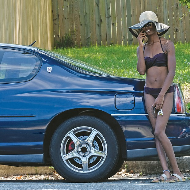 Beating the heat/ When temperatures settled in the 90s around Richmond and no relief was in sight, Richmonders turned to all kinds of activities to beat the heat. Angela Jackson was ready to head to the Fairmount Pool in the East End. (Sandra Sellars/Richmond Free Press)