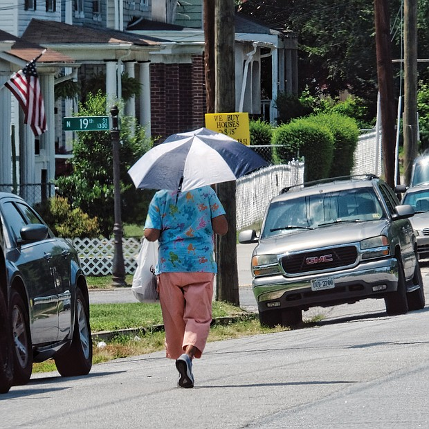 Beating the heat/ When temperatures settled in the 90s around Richmond and no relief was in sight, Richmonders turned to all kinds of activities to beat the heat. Some folks opened umbrellas to take shelter from the blazing sun, like the pedestrian walking along 19th and U streets in the East End last Saturday. (Sandra Sellars/Richmond Free Press)