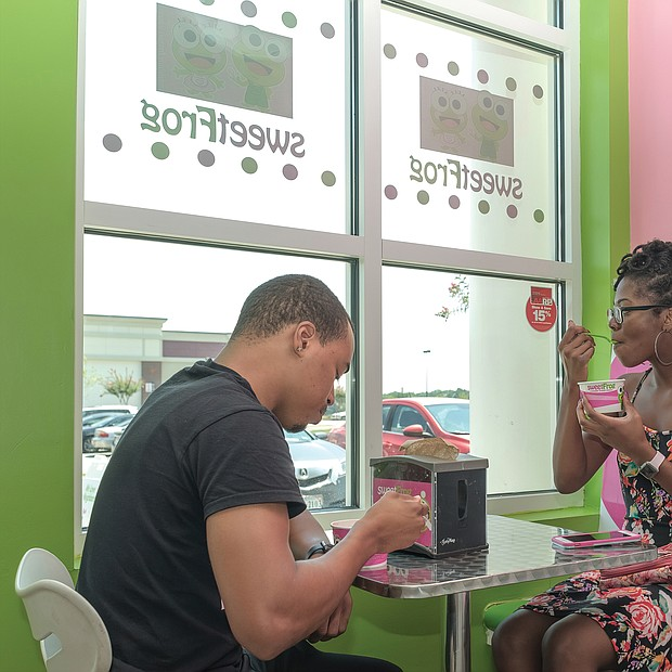 Beating the heat/ When temperatures settled in the 90s around Richmond and no relief was in sight, Richmonders turned to all kinds of activities to beat the heat. James Thornton and Deja Shabazz cooled off with a treat from Sweet Frog at the Stonebridge Shopping Center in Chesterfield County. (photo by Ava Reaves)