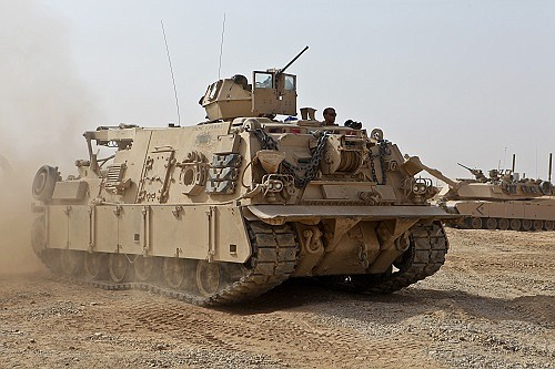 A U.S. military recovery vehicle rolls through an Afghanistan combat outpost in this U.S. Marine Corps file photo from 2011.