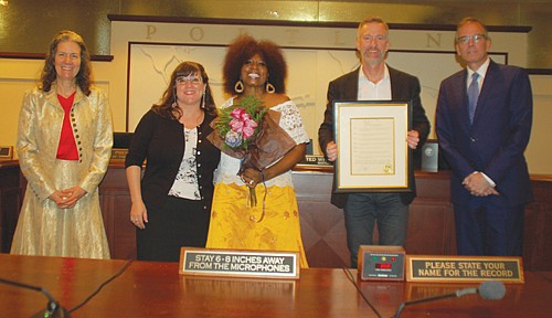 Retiring public servant Antoinette Edwards (center) is honored on her retirement by Mayor Ted Wheeler and the other members of the Portland City Council for her work in community advocacy and directing Portland's Office of Youth Violence Prevention.