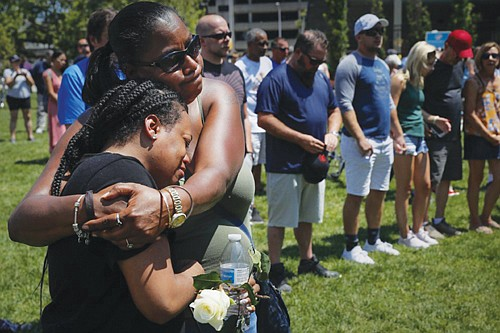 Mourners gather at a vigil following a nearby mass shooting this past Sunday, in Dayton, Ohio. It was the second mass shooting in the U.S. in less than 24 hours, with the first taking place in El, Paso, Texas, Saturday that authorities said appears to be a racially motivated hate crime.