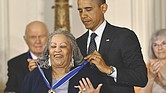 In 2012, President Obama awards a Presidential Medal of Freedom to prize-winning author Toni Morrison at the White House. The medal is the nation's highest civilian honor.