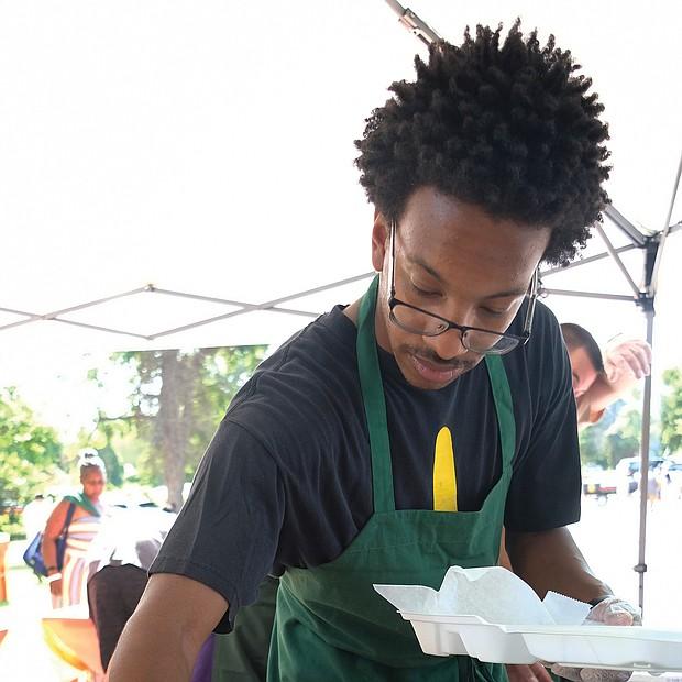 Marquis Smith serves up fish and fries at the 11th Annual St. Elizabeth Catholic Church Jazz & Food Festival. (Sandra Sellars/Richmond Free Press)